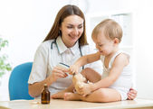 Doctor examining happy child boy — Stock Photo