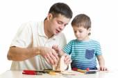 Dad and son kid make nesting box — Stock Photo