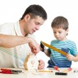 Father and son kid making wooden nesting box — Stock Photo #58396403