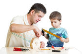 Father and son kid making wooden nesting box — Stock Photo