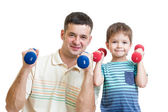 Man and kid son doing exercise with dumbbell together — Stock Photo