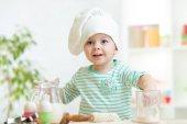 Little baker kid girl in chef hat — Stock Photo