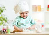 Smiling baker kid girl in chef hat — Stock Photo