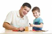 Father and son kid tinkering nesting box — Stock Photo