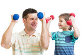 Daddy and kid son doing exercise with dumbbells together — Stock Photo