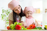Mother teaches daughter on kitchen — Stock Photo