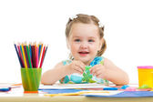 Lovely child drawing with colorful pencils — Stock Photo