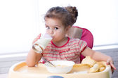 Pretty kid drinking milk from glass — Stock Photo