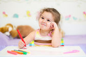 Little girl paints in nursery at home — Photo