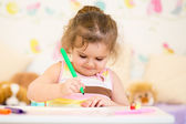 Child painting in nursery at home — Stock Photo