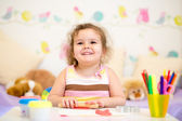 Kid girl drawing and making by hands — Stock Photo