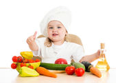 Beautiful little girl with food vegetables — Stock Photo