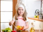 Child preparing healthy food at kitchen — Stock Photo