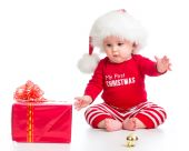 Little girl weared santa clothes with gift box isolated — Stock Photo