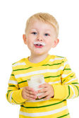 Kid boy drinking milk or yogurt — Stock Photo