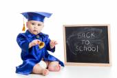 Funny baby with bell in academician clothes at chalkboard — Stock Photo