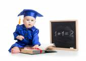 Baby with open book in academician clothes at chalkboard — Stock Photo