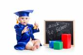 Funny kid with bell in academician clothes at chalkboard — Stock Photo