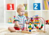 Kid playing with educational toy indoor — Stock Photo