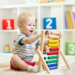 Kid boy playing with abacus — Stock Photo #60032441