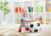 Kid boy with football  indoor — Stock Photo