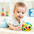 Baby boy playing with toys indoor — Stock Photo #60239479