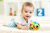 Baby boy playing with toys indoor — Stock Photo
