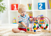 Funny child playing with educational toy indoor — Stock Photo