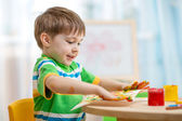 Child boy painting at home — Stock Photo
