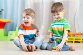 Kids boys with toys in playroom — Stock Photo