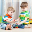 Children brothers play together in nursery — Stock Photo #60438089