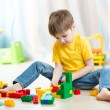 Kid boy playing with block toys at home — Stock Photo #60438173