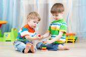 Children brothers play together in nursery — Stock Photo