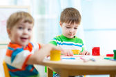 Kids painting in daycare or nursery or playschool — Stock Photo