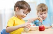 Children eating healthy food at home — Stock Photo