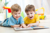 Happy kids friends reading together — Stock Photo