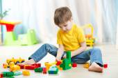 Kid boy playing with block toys at home — Stock Photo