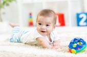 Baby boy playing with toy indoor — Stock Photo