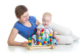 Child and mother play with educational toy — Stock Photo