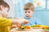 Kids eating in kindergarten — Stock Photo