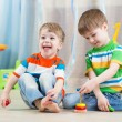 Children boys with toys in playroom — Stock fotografie #60634537