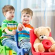 Two little boys playing role game in daycare — Stock fotografie #60634547