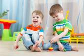 Children boys with toys in playroom — Stock Photo