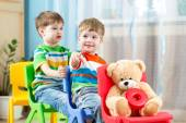 Two little boys playing role game in daycare — Stock Photo