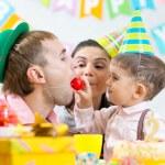 Parents have fun celebrating birthday of kid son — Stock Photo #61289229