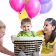 Family play at birthday party and playing with son in flight on a makeshift balloon — Stock Photo #61309401