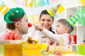 Parents have fun celebrating birthday of his son — Stock Photo