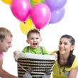 Family playing with son in flight on a makeshift balloon — Stock Photo #61500989