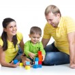 Kid with his parents play building blocks — Stock Photo #61501007
