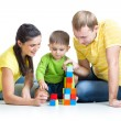 Kid with his parents play building blocks — Stock Photo #61582281